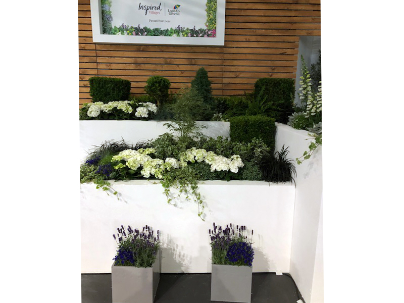 Clients own troughs on stage at Gardeners World